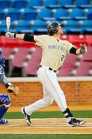 James Harris #22 of the Wake Forest Demon Deacons follows through on his swing against the UNC-Asheville Bulldogs at Wake Forest Baseball Park on February 28, 2012 in Winston-Salem, North Carolina.  The Demon Deacons defeated the Bulldogs 9-8.  (Brian Westerholt/Four Seam Images)