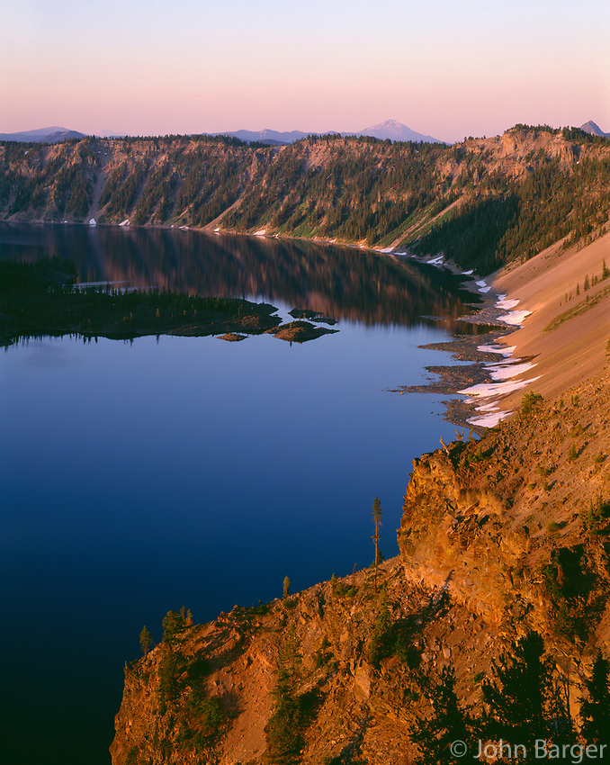 ORCL_036 - USA, Oregon, Crater Lake National Park, Sunrise light on Wizard Island, view south from Merriam Point with Mount Shasta and Mount McLoughlin visible in the distance.