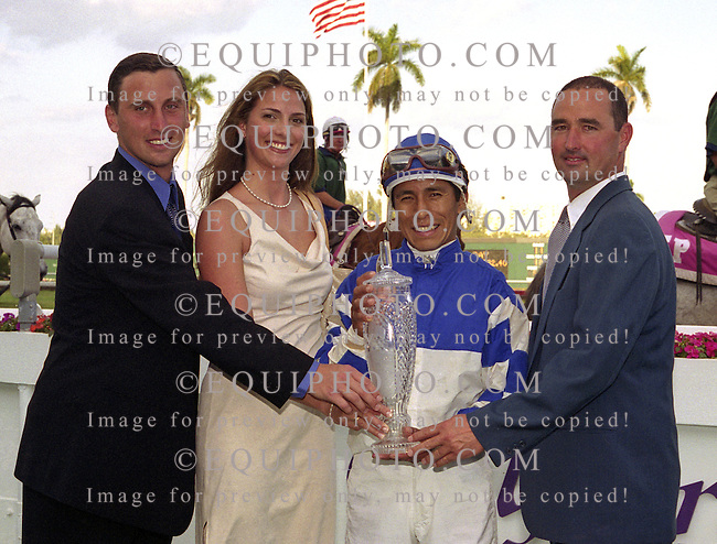 Bobby & Leslie Hurley, thoroughbred owners at Gulfstream Park in Hallandale, Florida with jockey Edgar Prado and trainer John Dowd (R) after Songandaprayer won the $200,000 Fountain Of Youth Stakes on 2/17/01.  Photo by Bill Denver/EQUI-PHOTO.