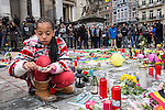 "BRUSSELS - BELGIUM - 23 March 2016 -- Belgium in mourning after the terrorist attack in  Maelbeek metro station - EU quarters, and the Brussels airport in Zaventem. -- Young girl Laura Wauty lights candles at the ""memorial"" at the Bourse in the city center. -- PHOTO: Juha ROININEN / EUP-IMAGES"