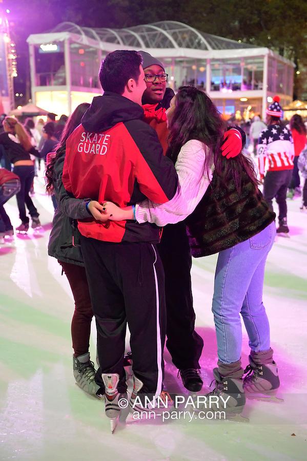 Manhattan, New York, U.S. 9th November 2013. Visitors ice skate and shop at the annual Holiday Shops, at Winter Village skating rink at Bryant Park that night,