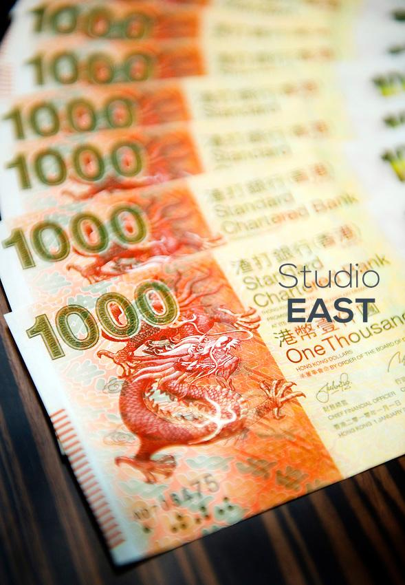 New Standard Chartered Bank 1,000 Hong Kong dollars banknotes, in Hong Kong, China, on January 25, 2011. Photo by Lucas Schifres/Pictobank