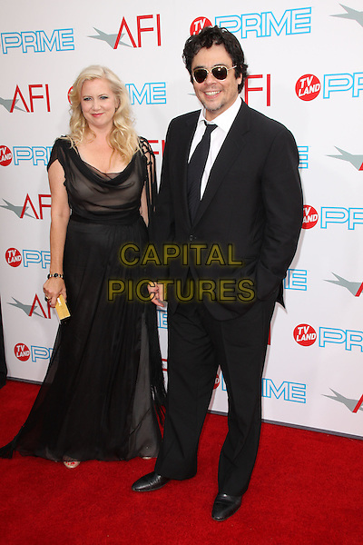 LAURA BICKFORD & BENICIO DEL TORO.37th Annual AFI Lifetime Achievement Awards held at Sony Pictures Studios, Culver City, California, USA..June 11th, 2009.full length black sheer dress suit sunglasses shades hand in pocket.CAP/ADM/KB.©Kevan Brooks/AdMedia/Capital Pictures.