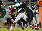 San Pedro, CA 11/27/15 - Jemal Williams (Mira Costa #6), Tre Gonzales (Palos Verdes #46) and Anthony Marron (Palos Verdes #26) in action during the CIF Western Division semi-final game between Mira Costa and Palos Verdes.  Palos Verdes defeated Mira Costa to advance to the Western Division finals.