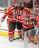 Mel Desrochers (SLU - 18), Amanda Boulier (SLU - 8), Ellie Williams (SLU - 24) - The Boston College Eagles defeated the visiting St. Lawrence University Saints 6-3 (EN) in their NCAA Quarterfinal match on Saturday, March 10, 2012, at Kelley Rink in Conte Forum in Chestnut Hill, Massachusetts.