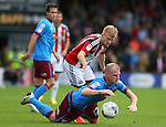 Mark Duffy of Sheffield Utd tussles with Neil Bishop of Scunthorpe Utd during the English League One match at Glanford Park Stadium, Scunthorpe. Picture date: September 24th, 2016. Pic Simon Bellis/Sportimage