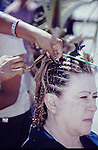 WOMEN GETS HAIR BRAIDED ON STREET IN SAN FELIPE (1)