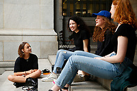 Leandra Mira, 17, protests for climate change on the steps  of the city county building with her friends Rachel Povloski (left), 20, Jacqueline LeKachman (blue hat), 18, and Kate Schaughnessy, 19, downtown on Friday June 21, 2019 in Pittsburgh, Pennsylvania. (Photo by Jared Wickerham/Pittsburgh City Paper)