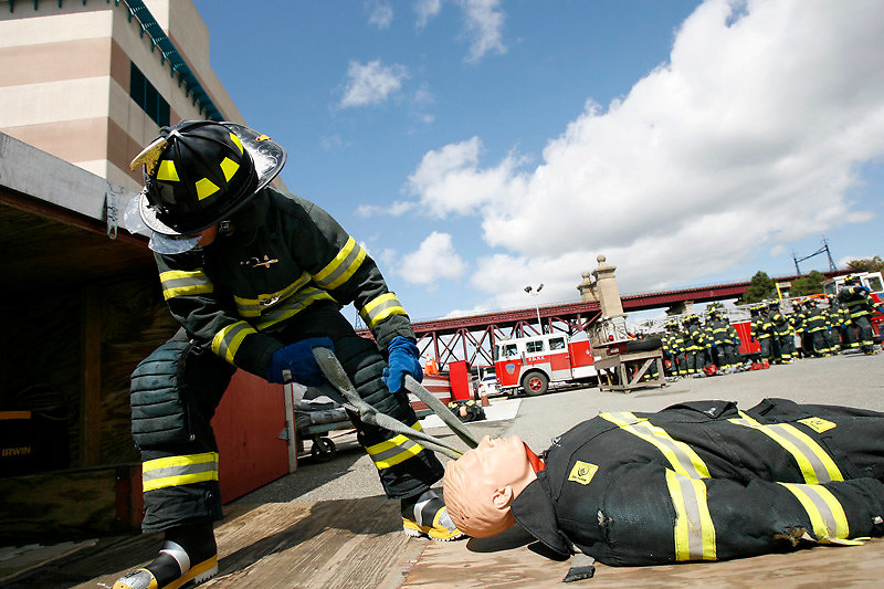 "A probationary firefighter - ""probie"" - completes an obstacle course during the intense, boot camp-style training at the New York City Fire Department's Fire Academy on Randall's Island, NYC, on Thursday, April 5, 2007.  The FDNY recently expanded their training program from 13 to 23 weeks."