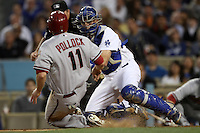 A.J. Ellis #17 of the Los Angeles Dodgers tags out A.J. Pollack #11 of the Arizona Diamondbacks at Dodger Stadium on May 14, 2012 in Los Angeles,California. Los Angeles defeated Arizona 3-1.(Larry Goren/Four Seam Images)