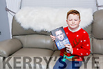 Michael O'Brien Killarney who starred in the Late Late Toy show last Friday with his autographed book by Davy Fitzgerald