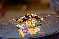Pictured: Cigarette butts extinguished on a litter bin next to festive club leaflets in Wind Street, Swansea. Monday 31 December 2018 and Tuesday 01 January 2019<br /> Re: New Year revellers in Wind Street, Swansea, Wales, UK