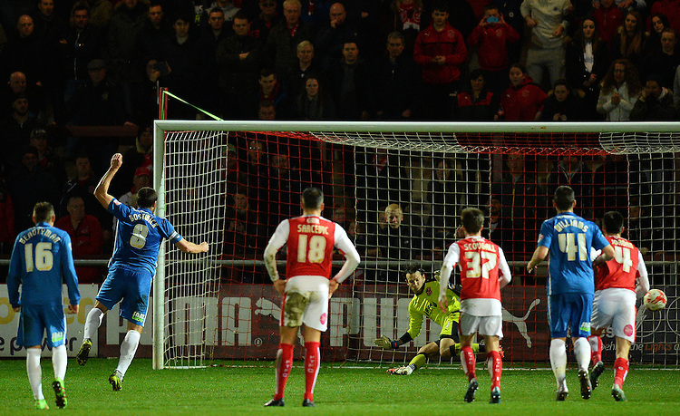 Fleetwood Town's Chris Maxwell saves the penalty kick of Peterborough United's Michael Bostwick<br /> <br /> Photographer Richard Martin-Roberts/CameraSport<br /> <br /> Football - The Football League Sky Bet League One - Fleetwood Town v Peterborough United - Tuesday 5th April 2016 - Highbury Stadium - Fleetwood   <br /> <br /> &copy; CameraSport - 43 Linden Ave. Countesthorpe. Leicester. England. LE8 5PG - Tel: +44 (0) 116 277 4147 - admin@camerasport.com - www.camerasport.com