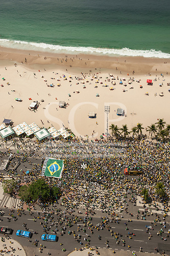 Protesters carry a huge Brazilian flag on the beach at Copacabana. Rio de Janeiro, Brazil, 15th March 2015. Popular demonstration against the President, Dilma Rousseff in Copacabana. Photo © Sue Cunningham sue@scphotographic.com.