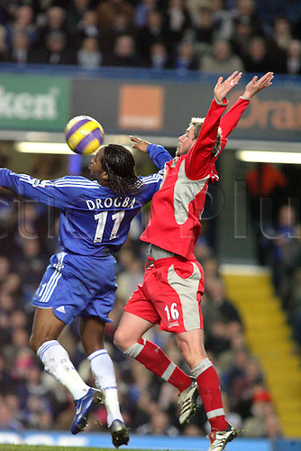 31 January 2007: Chelsea striker Didier Drogba competes with Stephane Henchoz for the ball during the Premiership game between Chelsea and Blackburn Rovers, played at Stamford Bridge. Chelsea won the match 3-0. Photo: Actionplus....070131 football soccer player