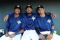 Columbia Fireflies players from Venezuela pose for a photo in the dugout prior to a game against the Lexington Legends on Thursday, June 8, 2017, at Spirit Communications Park in Columbia, South Carolina. From left are Luis Caspio. Ali Sanchez and Andres Gimenez. Columbia won, 8-0. (Tom Priddy/Four Seam Images)