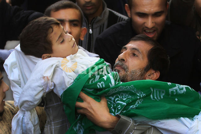 Palestinians carry the bodies of brothers Suhaib, 2-years-old, and Mohammed Hejazi, 4-years-old, during their funeral in the northern Gaza Strip area of Biet Lahia, on November 20, 2012. Four members of the Hejazi family were killed in the Israeli air strike in Gaza, the Hamas Health Ministry said. Photo by Sameh Rohmi