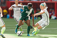 June 16, 2015: Courtney DIKE of Nigeria controls the ball during a Group D match at the FIFA Women's World Cup Canada 2015 between Nigeria and the USA at BC Place Stadium on 16 June 2015 in Vancouver, Canada. USA won 1-0. Sydney Low/Asteriskimages.com