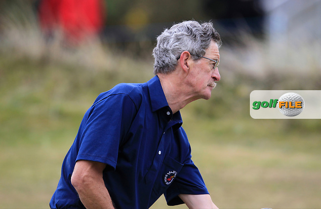 Dick Spring (AM) on the 4th green during the Pro-Am of the 2015 Dubai Duty Free Irish Open, Royal County Down Golf Club, Newcastle Co Down, Northern Ireland. 27/05/2015<br /> Picture Thos Caffrey, www.golffile.ie