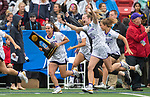 STONY BROOK, NY - Corinne Schmidt #16 and Lexie Van Kirk #36 of the James Madison Dukes react to winning the Division I Women's Lacrosse Championship held at Kenneth P. LaValle Stadium on May 27, 2018 in Stony Brook, New York. (Photo by Ben Solomon/NCAA Photos via Getty Images)