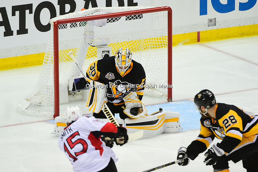 May 25, 2017: Pittsburgh Penguins goalie Matt Murray (30) stops a shot by Ottawa Senators center Zack Smith (15)  during game seven of the National Hockey League Eastern Conference Finals between the Ottawa Senators and the Pittsburgh Penguins, held at PPG Paints Arena, in Pittsburgh, PA. The Pittsburgh Penguins defeat the Ottawa Senators 3-2 in double overtime to win the NHL Eastern Conference Championship and advance to face the Nashville Predators in the Stanley Cup Finals.  Eric Canha/CSM