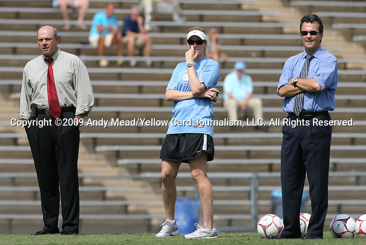 30 August 2009: North Carolina head coach Anson Dorrance (right) with volunteer assistant coach Cindy Parlow (center) and assistant coach Bill Palladino (left). The University of North Carolina Tar Heels defeated the University of North Carolina Greensboro Spartans 1-0 at Fetzer Field in Chapel Hill, North Carolina in an NCAA Division I Women's college soccer game.