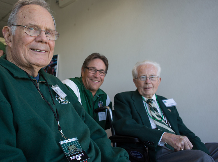 Charles J. Ping, left, Dave Scholl, center, and Will Konneker, right, take a break from watching the Ohio University Homecoming football game against Miami University to pose for a picture on October 10, 2015 at Peden Stadium. Photo by Emily Matthews