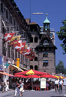 outdoor café, Switzerland, Geneva, Outdoor café with red umbrellas at Place du Molard in the old town of the city of Geneva.