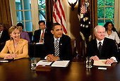 Washington, D.C. - April 20, 2009 -- United States President Barack Obama holds his first Cabinet meeting in the Cabinet Room of the White House in Washington, D.C. on Monday, April 20, 2009.  From left to right:  Secretary of State Hillary Rodham Clinton; The President; Secretary of Defense Robert Gates..Credit: Ron Sachs / Pool via CNP