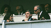 Washington Redskin owner Jack Kent Cooke, right, is shown in his box during a game against the Phoenix Cardinals with United States Vice President Dan Quayle, center, and Marilyn Quayle, left, at RFK Stadium on October 10, 1989.<br /> Credit: Arnie Sachs / CNP