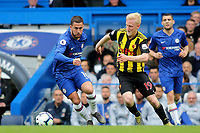 Eden Hazard of Chelsea in action as Watford's Will Hughes looks on during Chelsea vs Watford, Premier League Football at Stamford Bridge on 5th May 2019