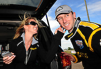 Mar. 12, 2012; Gainesville, FL, USA; NHRA top fuel dragster driver Morgan Lucas celebrates with fiance Katie Pallone after winning the Gatornationals at Auto Plus Raceway at Gainesville. The race is being completed on Monday after rain on Sunday. Mandatory Credit: Mark J. Rebilas-