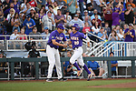 OMAHA, NE - JUNE 26: Antoine Duplantis (20) of Louisiana State University shakes hands with his third base coach as he approaches home after hitting a solo home run against the University of Florida during the Division I Men's Baseball Championship held at TD Ameritrade Park on June 26, 2017 in Omaha, Nebraska. The University of Florida defeated Louisiana State University 4-3 in game one of the best of three series. (Photo by Jamie Schwaberow/NCAA Photos via Getty Images)