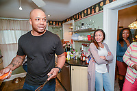 Kevin Overton, of Philadelphia chats as his sisters, Sally Armstrong of Dallas, Texas, Cherjon Overton of Deptford, New Jersey and Sterling Overton-Crawford of Fredericksburg, Virginia look on Saturday, May 19, 2018 in Philadelphia, Pennsylvania. Sally Armstrong used a 23andMe Health + Ancestry kit to find her four half siblings. She met them for the first time Friday. (Photo by William Thomas Cain/CAIN IMAGES)