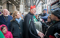 """Timothy Cardinal Dolan of the Archdiocese of NY, right, with  Linda Mirels, board chair of the UJA-Federation, center, and Msg. Kevin Sullivan,  exec. director of Catholic Charities, left, promoting the 3rd annual """"Feeding our Neighbors: An Interfaith Response"""" in front of St. Patrick'sCathedral in New York on Sunday, January 19. 2014. The campaign is an interfaith effort between Catholic and Jewish social service organizations to collect food donations to re-fill the sorely depleted food pantries, meal programs  and soup kitchens that serve those in need.  (© Richard  B. Levine)"""