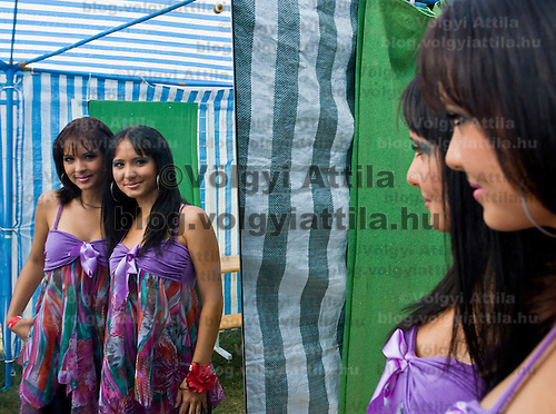 Twin couple is reflected in the mirror befre the beauty contest held during the 10th International Twin Festival.