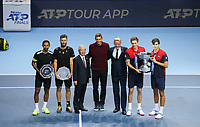sports; sporting; tennis; mens; trophy; champion; O2 Arena; London; England; Nitto ATP finals Pierre-Hugues Herbert (FRA) and Nicolas Mahut (FRA) with Winners trophy as Raven Klaasen (RSA) and Michael Venus (NZL) hold their runner up trophies - Editorial Use