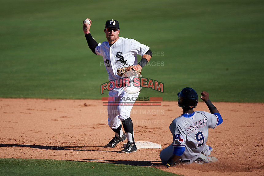 Glendale Desert Dogs second baseman Jake Peter (18) throws to first on a double play attempt as Jurickson Profar (9) slides into second during an Arizona Fall League game against the Surprise Saguaros on October 24, 2015 at Camelback Ranch in Glendale, Arizona.  Surprise defeated Glendale 18-3.  (Mike Janes/Four Seam Images)
