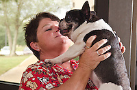 Veterinary technician, Lisa Pritchard, poses with patient, Mitsy.