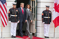United States President Donald J. Trump and First Lady of the United States Melania Trump exit the White House as they prepare to welcome Prime Minister of Canada Justin Trudeau and his wife Sophie Gr&Egrave;goire to the White House on October 11th, 2017 in Washington, D.C. <br /> CAP/MPI/RS<br /> &copy;RS/MPI/Capital Pictures