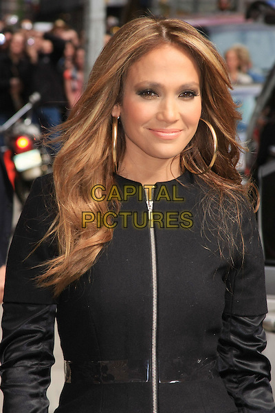 "JENNIFER LOPEZ.Jennifer Lopez (promoting ""The Back-Up Plan"") at the Ed Sullivan Theater for an appearance on the 'Late Show with David Letterman', New York, NY, USA>.April 19th, 2010.half length j-lo black coat jacket zip zipper clear plastic belt gold hoop earrings .CAP/LNC/TOM.©TOM/LNC/Capital Pictures."