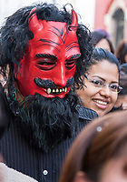 Oaxaca, Mexico, North America.  Day of the Dead Celebrations.  Parade Marcher Wearing a Devil's mask in Memory of the Dead.