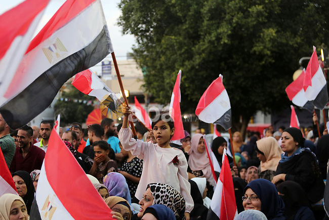 """Palestinians wave the Egyptian flags during a rally to say """"Thank"""" to Egypt for its support for Palestinian reconciliation, in Gaza city on September 25, 2017. Photo by Mohammed Asad"""