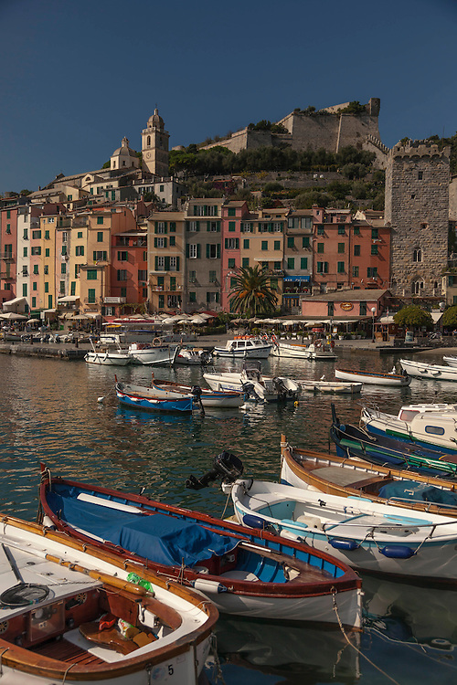 Pastel colored buildings form the backdrop over Portovenere's picturesque harbor colored buildings form the backdrop over Portovenere's picturesque harbor
