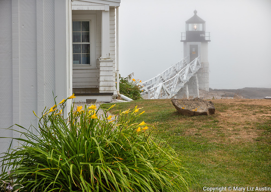 Popint Clyde, ME: Marshall Point Lighthouse (1857) in the fog from the lighthouse keeper's residence on Marshall Point
