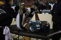 12 December 2004: Terrell Owens gets his back and legs worked on after taking a hard hit from Sean Taylor.<br />The Philadelphia Eagles defeated the Washington Redskins 17-14 December 12, 2004 at FedEx Field in Landover MD.<br />Mandatory Credit: Randy Litzinger