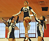 Alexis Camileri of Oceanside, center, performs alongside teammates Molly Eisenberg, left, and Ashley Antelo during the varsity segment of the Freeport Devil Winter Cheerleading Competition at Freeport High School on Sat, Dec. 16, 2017.