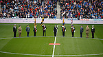 Members of the armed forces in the centre circle at Ibrox for Remembrance