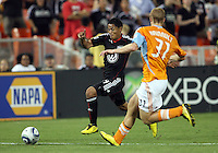 Andy Najar #14 of D.C. United cuts past Andrew Hainault #31 of the Houston Dynamo during an MLS match at RFK Stadium in Washington D.C. on September  25 2010. Houston won 3-1.