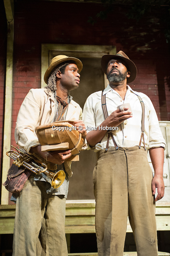 London, UK. 21.06.2013. FENCES, by August Wilson, opens at the Duchess Theatre, in London's West End, following a successful run at Theatre Royal Bath. Lenny Henry takes on the lead role of Troy Maxson in, this production, which is directed by Paulette Randall. Picture shows: Ako Mitchell (Gabriel) and Lenny Henry (Troy Maxson). Photograph © Jane Hobson.